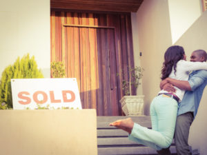home-for-sale-with-couple-hugging
